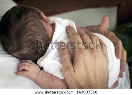 Father holding newborn baby - stock photo
