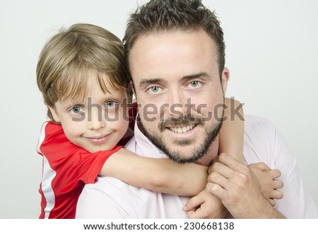 Father holding son - stock photo