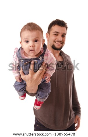 father holds the baby's chest.Isolated over white. - stock photo