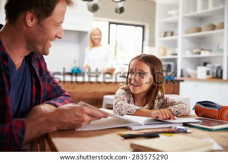 Father home schooling his young daughter - stock photo