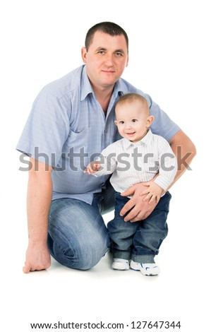 father hugs little son isolated on white background - stock photo