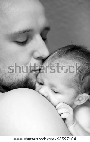 Father kiss lovely his baby - stock photo