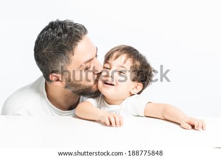Father kissing his preschooler son - stock photo