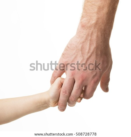 Father leads his child. Trust, family, assistance, parenting, childhood concept. Man's and kid's hands closeup over white background.