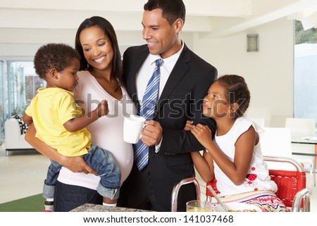 Father Leaving Family Breakfast For Work - stock photo