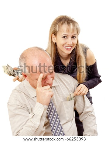 Father Looking Upset as his  Daughter takes Money - stock photo
