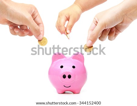 Father, mother, and baby in the family do saving money in pink piggy bank - stock photo