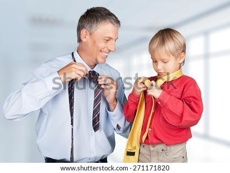 Father. Photo of happy boy and his father tying neckties - stock photo