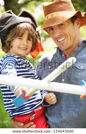 Father Playing Exciting Adventure Game With Son In Summer Field