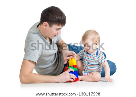 father playing with baby boy - stock photo