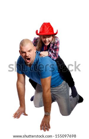 father playing with her daughter on a white background - stock photo