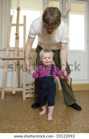 father playing with his blond son