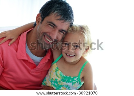 Father playing with his daughter at home