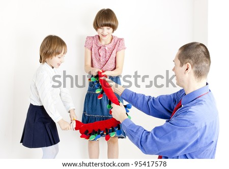 father playing with his daughters - stock photo