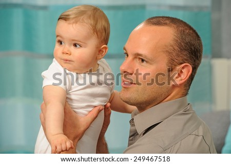 Father playing with his little baby. Quality time father and daughter. - stock photo