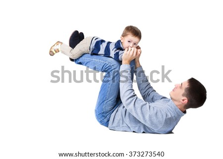 father playing with little son. a little child and dad. family.