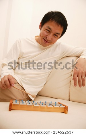 Father Playing with Toy Xylophone