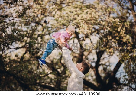 Father plays with his boy - stock photo