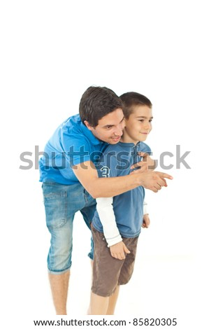 Father pointing away and showing something to his son isolated on white background - stock photo