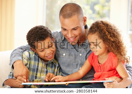 Father reading to children - stock photo