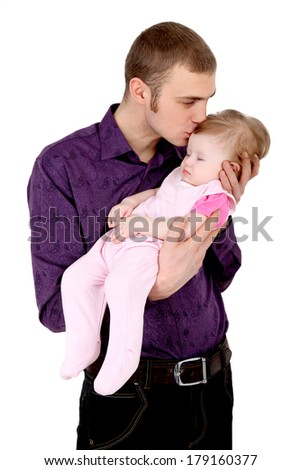Father's love. Father kisses sleeping daughter on his hands gently.