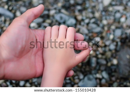 father's outstretched hand of trust to his son, a strong family friendship - stock photo