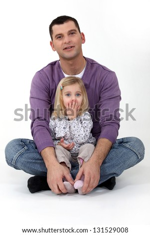 Father sat with daughter - stock photo