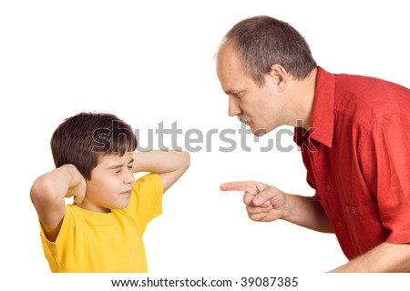 Father scolding his son with pointed finger