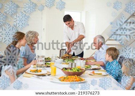 Father serving meal to family against snowflake frame