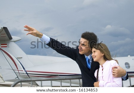 Father show his daughter airplane