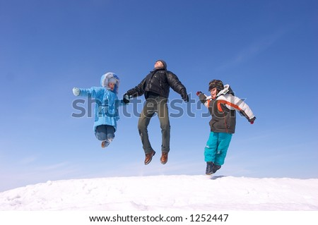 Father son and daughter jumping - stock photo