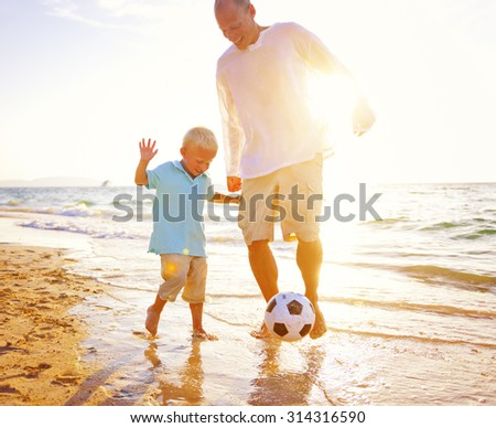 Father Son Playing Beach Football Happiness Concept