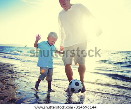 Father Son Playing Soccer Beach Summer Concept - stock photo