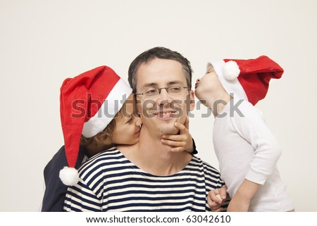 Father, sons and christmas cap - stock photo