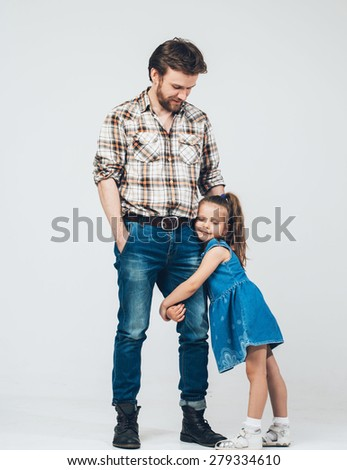 Father take hand daughter full length hug  - stock photo