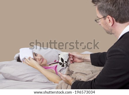 father taking care of teenager with cold or flu - stock photo