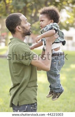 Father talking to his young son - stock photo