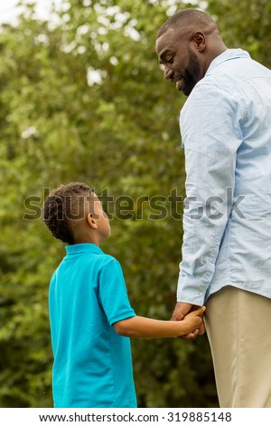 Father talking with his son. - stock photo