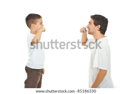 Father teaching his son to brushing teeth isolated on white background - stock photo