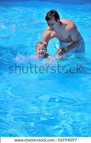 father teaching son to swim, he almost can do it