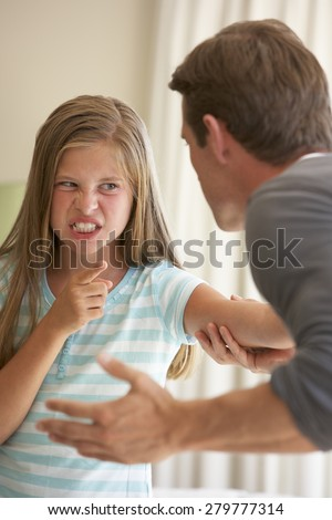 Father Telling Off Daughter At Home - stock photo