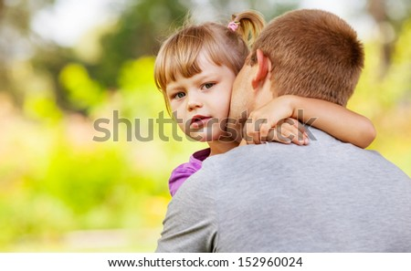 Father tender kiss his little daughter - stock photo