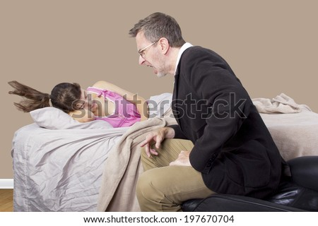 father waking up young girl in the morning