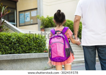 Father Walking To School With Children - stock photo