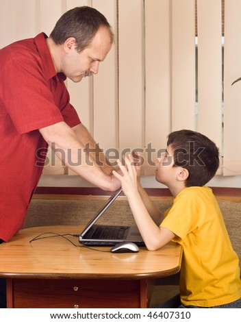 Father warning his son to stop playing - isolated
