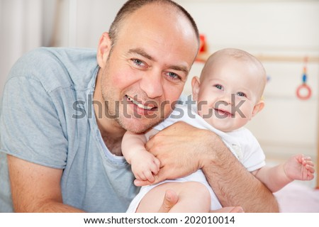 father with baby - stock photo