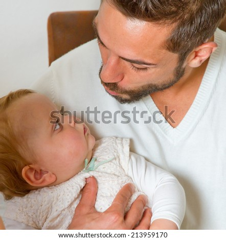 Father with baby in arms