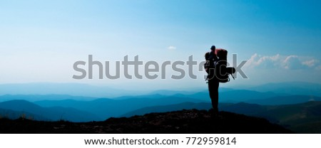 Father with baby son in mountainous  areas. Travel adventure and hiking activity with child, active and healthy lifestyle banner.