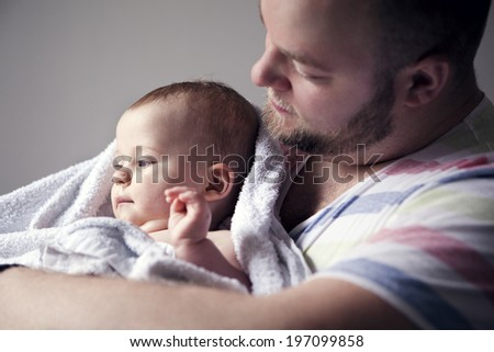 Father with baby son, London, United Kingdom - stock photo