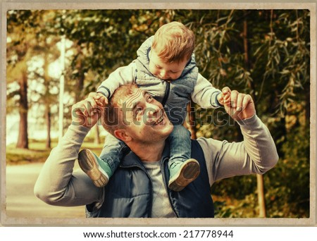 father with child in the park - stock photo